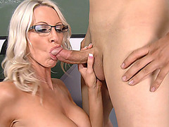 Professor Emma Starr sucks young cock in the classroom