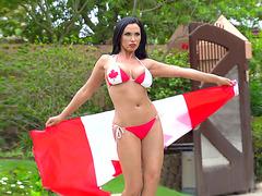 Busty pornstar Nikki Benz posing with Canadian flag