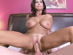 Brunette mom Tara Holiday riding a sexy young guy