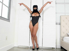 Masked babe Kylie Rogue teases in a bodysuit with her big tits