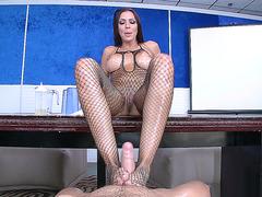 Fishnet porn star Rachel Starr giving a slippery footjob