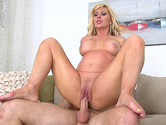 Impeccable blonde mom Sasha Sean fucks her young fling on couch