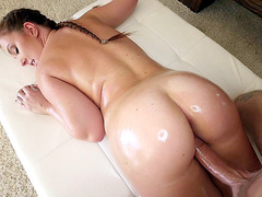 Curvy slut Maddy O'Reilly oiled up and pussy spanked