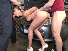 Tattooed babe Rilynn Rae gets fucked by two car mechanics doggy style