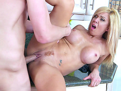 Wife Parker Swayze fucked on her kitchen counter by young lover
