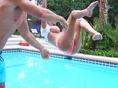 Big boobed porn queen Peta Jensen shows her big boobies by the pool