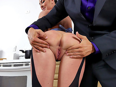 Brunette babe Brittany Shae gets anal fingering in the kitchen