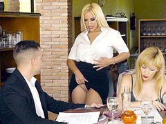 Blondie Fesser is revealing her huge tits in the restaurant