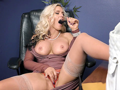 Alena Croft is in her clothes in this video in office
