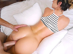 Jada Stevens is prone on the bed as she is fucked