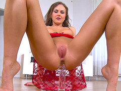 Tina Kay is doing anal sex with a glass dildo