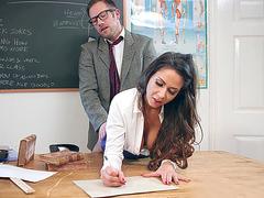 Roxxy Lea is rammed on the desk in the classroom