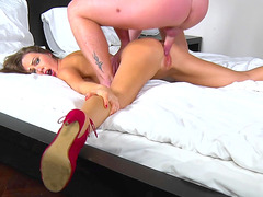 Tina Kay is prone on the bed as she is getting fucked