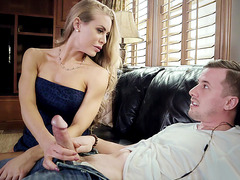 Nicole Aniston is teasing a large dick with her hands