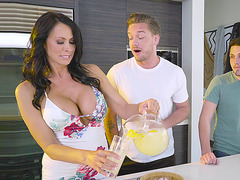 Dude gets seduced by Reagan Foxx' big boobs in the kitchen