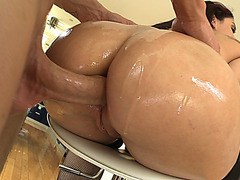 Sheena Ryder with her butt hanging off the stool getting her asshole rammed