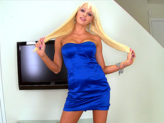 Rikki Six wearing blue dress posing in front of the camera