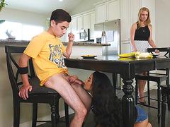Latina cutie Maya Bijou gives blowjob under the table