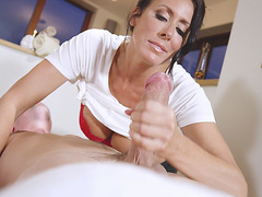 Reagan Foxx jerks and sucks cock on the massage table