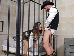 MILF Lela Star gives blowjob in the jail