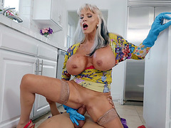 Huge titted Sally D'Angelo rides the hard rod on the floor