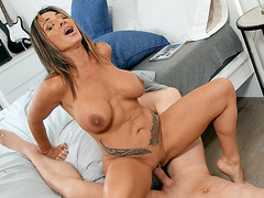 Busty mom Aubrey Black rides the hard dick with her shaved pussy