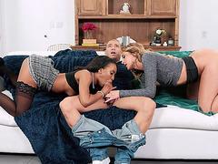 Charlotte Sins and Demi Sutra orally pleasure Xander's dick