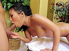 Oiled up babe Asa Akira works all over his big penis orally