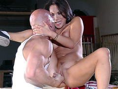 Asa Akira sitting on the table getting her both holes fingered