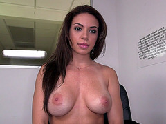 Kylie Rogue whips her fake tits out of her bra for our pleasure