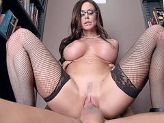 Kendra Lust wearing glasses and riding it in the library