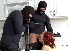 Sophia Locke giving head to a couple of burglars in the kitchen