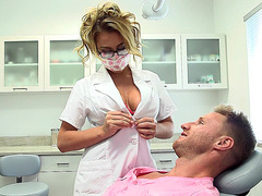 Buxom nurse Corinna Blake pushes her tits into his face